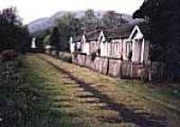Looking west towards the former station by railway cottages at Aberfoyle. Impressions of sleepers remain on ground.<br><br>[Ewan Crawford&nbsp;//]