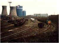 View looking east over a marshalling yard in the Ravenscraig Steelworks. Class 37 delivering a train of scrap.<br><br>[Ewan Crawford&nbsp;//]