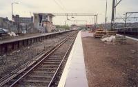 Looking east at Airdrie station. 303 in bay platform and electrification train in sidings.<br><br>[Ewan Crawford&nbsp;//1987]
