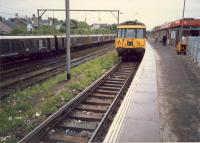 Looking west at Airdrie station. Electrification train in sidings. These are mostly lifted now.<br><br>[Ewan Crawford&nbsp;//1987]