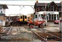 Looking north at Balloch Central across the level crossing. Class 314 in station.<br><br>[Ewan Crawford&nbsp;//]
