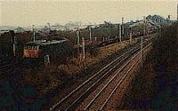 Northbound empty steel coil wagons for Ravenscraig running north to Mossend via Holytown passing Law Junction.<br><br>[Ewan Crawford&nbsp;//]