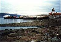 Wemyss Bay station and pier with a Caledonian MacBrayne ferry at the pier.<br><br>[Ewan Crawford&nbsp;//]