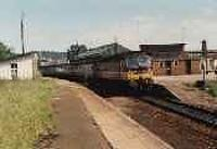 Class 47 hauled passenger train stopped at Forres station. View looks east.<br><br>[Ewan Crawford&nbsp;//]