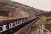 Class 47 hauled passenger train heads south at Slochd crossing.<br><br>[Ewan Crawford&nbsp;//]