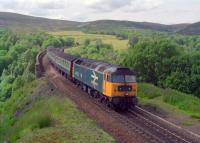 A class 47 hauled passenger train runs south over Slochd viaduct.<br><br>[Ewan Crawford&nbsp;//]