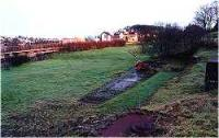 View looking south over the site of the former Helmsdale engine shed towards Helmsdale station.<br><br>[Ewan Crawford&nbsp;//]