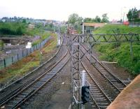View looking west from Gartsherrie Road over Sunnyside Junction in 1987. The line running off to the south is the freight only link to Whifflet South Junction. The line turning north under the bridge alongside the signal box latterly served Gartsherrie cement works and Gunnie Yard. The land beyond the fence on the left is part of Summerlee Heritage Museum.<br><br>[Ewan Crawford&nbsp;//1987]