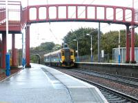 A Glasgow bound train arrives at Curriehill station in October 2002.<br><br>[John Furnevel&nbsp;27/10/2002]