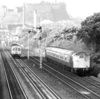 A Type 2 powered push-pull service overtakes a DMU at Saughton in May 1975, with Edinburgh Castle dominating the background.<br><br>[John Furnevel&nbsp;30/05/1975]
