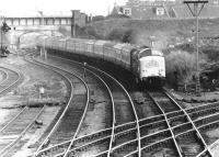 A Deltic brings train 1S17, the thirteen coach down Flying Scotsman, effortlessly past Portobello East Junction in October 1972. The bridge and embankment in the background carried the Lothian Lines over the ECML.<br><br>[John Furnevel&nbsp;30/10/1972]