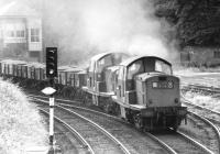 Claytons 8598+8528 passing Morningside Road signal box on the Edinburgh 'sub' in the summer of 1971 with an eastbound ballast train.<br><br>[John Furnevel&nbsp;20/07/1971]