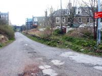 The remains of Merchiston station looking west in April 2002. The road along the former trackbed is now the eastern vehicle access to Slateford Yard. <br><br>[John Furnevel&nbsp;19/04/2002]