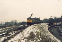 Class 47 with flatbed train and crane lifting track at Trinity during the lifting of the line between Granton and Powderhall. View looks east.<br><br>[Alan Bain&nbsp;//]