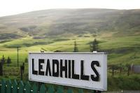 Looking west from Leadhills station over the station signboard.<br><br>[Ewan Crawford&nbsp;15/08/2004]