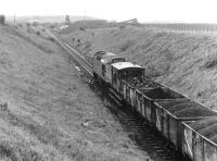 Pushing coal uphill. A loaded coal train leaving Littlemill Colliery, Ayrshire, in 1973, the year before closure.<br><br>[John Furnevel&nbsp;//1973]