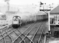 A freight from the Forth Bridge direction is about to pass Saughton Junction signal box in 1971 as it crosses onto the Glasgow - Edinburgh line to reach the sub at Haymarket West Junction.<br><br>[John Furnevel&nbsp;11/11/1971]