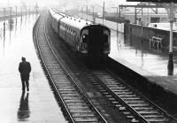 Where is he going in this weather? Glasgow Central - Stranraer train arrives at Ayr in a thunderstorm in the spring of 1972.<br><br>[John Furnevel&nbsp;02/03/1972]