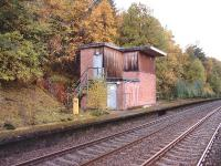 The disused Signal Box at Tomatin.The milepost indicates 99 miles from Perth.<br><br>[John Gray&nbsp;14/10/2004]