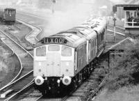 The up Royal Train 1X00 passing Dumfries south signal box in March 1972, hauled by a pair of immaculate looking type 2 diesel locomotives.<br><br>[John Furnevel&nbsp;24/03/1972]