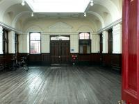 The striking entrance and former booking hall at Elgin East, September 2004. The old building is now in use as commercial offices.<br><br>[John Furnevel&nbsp;12/09/2004]