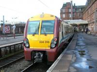 A train for Glasgow Central awaiting its departure time at Ayr station in July 2002.<br><br>[John Furnevel&nbsp;12/07/2002]