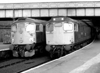 <I>'No, no, I insist... after you..!'</I> Glasgow and Edinburgh bound trains preparing to leave the west end bays at Dundee station in the summer of 1981.<br><br>[John Furnevel&nbsp;12/08/1981]