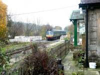 A westbound train on the Wensleydale Railway about to pass over Wensley station level crossing on its way to Redmire in October 2004. [See image 32272]<br><br>[John Furnevel&nbsp;30/10/2004]