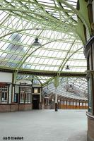 View from the ends of platforms 3 and 4 looking through the circulating area to the glazed pier walkway. The stations clock tower can be viewed through the glazed roof to the left.<br><br>[Ewan Crawford&nbsp;4/6/2004]