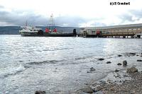 Looking northeast from the beach to the end of the pier and Caledonian MacBrayne ferry. The glazed and curved walkway from pier to station can be seen.<br><br>[Ewan Crawford&nbsp;4/6/2004]