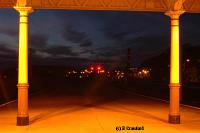 Looking north from the end of the canopies over platforms 1 and 2. The Inverkip Power Station chimney can be seen in the distance; two vertically spaced red lights in the right centre of the view.<br><br>[Ewan Crawford&nbsp;4/6/2004]