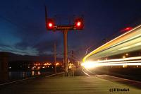 Looking north as a train enters from Glasgow. The lights of Wemyss Bay are reflected in the Firth of Clyde to the left.<br><br>[Ewan Crawford&nbsp;4/6/2004]
