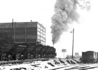 Off to the tip... a spoil train leaving a snowy Dunaskin washery on the Waterside complex in December 1971 heading for Cutler Tip. The loaded wagons on the right in the Cutler Sidings are awaiting collection by BR [see image 3579]. <br><br>[John Furnevel&nbsp;01/12/1971]