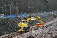Rail mounted crane reaches the present end of the Larkhall branch. It is delivering sleepers to just north of Merryton station.<br><br>[Ewan Crawford&nbsp;20/03/2005]