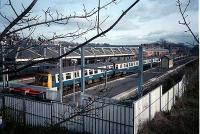Class 303 sits in Milngavie station on a sunny winter day.<br><br>[Ewan Crawford&nbsp;//]