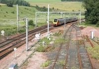 An up Voyager runs past the south end of the loops at Grantshouse in July 2006 approaching the PW sidings on the site of the old station.<br><br>[John Furnevel&nbsp;04/07/2006]