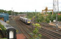 Glasgow - Edinburgh shuttle heads past the old Freightliner depot at Portobello on 9 July 2006 on its way to Waverley having been diverted around the sub due to line closure at Haymarket.<br><br>[John Furnevel&nbsp;09/07/2006]