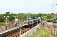 A Cumbernauld - Glasgow Queen Street train leaving Stepps station in July 2006.<br><br>[John Furnevel&nbsp;26/07/2006]