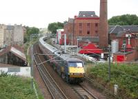 GNER Kings Cross - Glasgow Central service passing the renowned Caledonian Brewery (1869) in Slateford Road, Edinburgh, shortly after leaving Haymarket East Junction on 27 July 2006.<br><br>[John Furnevel&nbsp;27/07/2006]