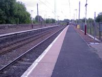 A Class 318 about to pass through Lochwinnoch Station with a fast train to Glasgow.<br><br>[Graham Morgan&nbsp;14/06/2006]