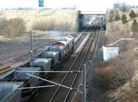 Coal empties restarting northbound from Millerhill yard in February 2002 following a signal check. Newcraighall station is under construction just beyond the bridge and part of what will become the new turnback siding is visible on the left. The new station and siding became operational four months later.<br><br>[John Furnevel&nbsp;13/02/2002]