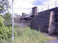 Looking east towards Paisley, this shows the fly-under as it is now. The bridge is still in place, but the this part of the track bed is now the site of a re-cycling plant and haulage yard.<br><br>[Graham Morgan&nbsp;26/06/2006]