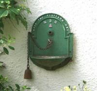 Interesting ornamental plant container attached to the wall of a house near the former Pomathorn station, Penicuik, in August 2006.<br><br>[John Furnevel&nbsp;06/08/2006]
