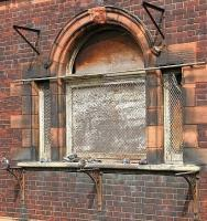 Pigeon perch in Partick. South window of the old Partick Central station in August 2006.<br><br>[John Furnevel&nbsp;27/08/2006]