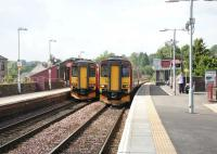 Trains from Glasgow Central and Kilmarnock pass at Barrhead in August 2006. View south.<br><br>[John Furnevel&nbsp;17/08/2006]
