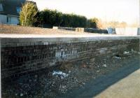 Southbound platform face of the island platform at Kilbarchan seen from the trackbed. The northern station entrance ramp is to the right. Sustrans had just finished repairing the platform brickwork and added a new platform edge.<br><br>[Ewan Crawford&nbsp;//1987]