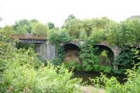 Looking south over the River Kelvin in August 2006 at the massive retaining walls and viaduct that brought the Lanarkshire and Dumbartonshire Railway across the river to Maryhill Central.<br><br>[John Furnevel&nbsp;02/08/2006]