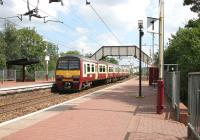 Looking along platform 1 at Coatdyke station in August 2006 as a train for Airdrie departs.<br><br>[John Furnevel&nbsp;/08/2006]