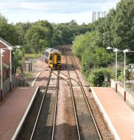 Maryhill station in August 2006 with a train for Glasgow Queen Street coming off the line from Anniesland at Maryhill Park Junction.  <br><br>[John Furnevel&nbsp;14/08/2006]