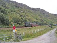 The Jacobite drops down to the crossing at Kinloid Farm between Arisaig and Morar.<br><br>[John Robin&nbsp;22/08/2006]